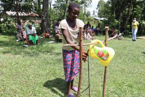 The Water Project: Muyundi Community, Baraza Spring -  A Girl Making Use Of The Handwashing Station
