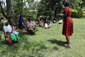 The Water Project: Muyundi Community, Baraza Spring -  Ms Shigali Holding Up A Mask