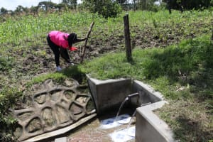 The Water Project: Muyundi Community, Ngalame Spring -  Building A Stand For The Reminder Chart