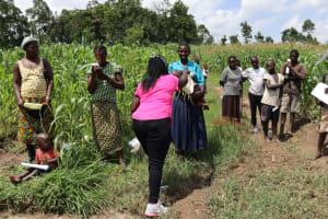 The Water Project: Muyundi Community, Ngalame Spring -  Distributing Masks Made At Training