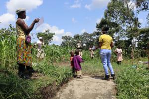 The Water Project: Muyundi Community, Ngalame Spring -  Ms Georgina Leading The Training Session