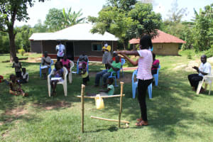 The Water Project: Musango Community, Ndalusia Spring -  Clean Hands Keep Corona Away