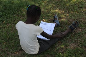 The Water Project: Musango Community, Ndalusia Spring -  Following Training Using A Handout