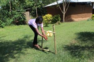 The Water Project: Musango Community, Ndalusia Spring -  Using A Setup Handwashing Point