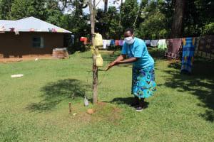 The Water Project: Musango Community, Ndalusia Spring -  Using A Setup Handwashing Station