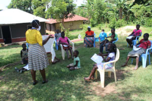The Water Project: Musango Community, Ndalusia Spring -  Using Charts To Pass Message Of Covid To Participants