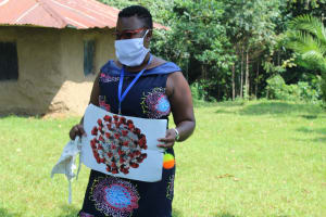 The Water Project: Ilala Community, Arnold Johnny Spring -  Facilitator Using A Visual Aid At The Training