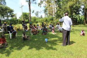 The Water Project: Ilala Community, Arnold Johnny Spring -  Village Elder Addresses Community Members