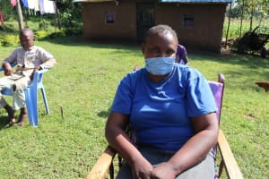 The Water Project: Mukangu Community, Lihungu Spring -  Community Health Worker With Her Mask On