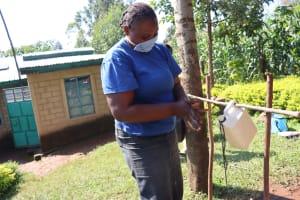 The Water Project: Mukangu Community, Lihungu Spring -  Handwashing At The Insatlled Tippy Tap