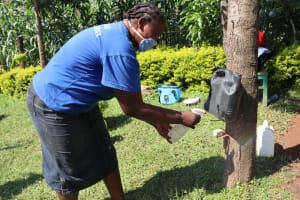 The Water Project: Mukangu Community, Lihungu Spring -  Sanitizing With Alcohol Based Hand Sanitizer