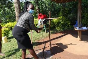 The Water Project: Mukangu Community, Lihungu Spring -  Using A Leaky Tin
