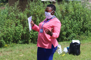 The Water Project: Lukova Community, Wasike Spring -  Facilitator Leading The Training