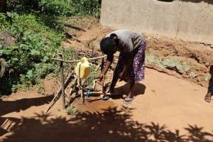 The Water Project: Emulakha Community, Nalianya Spring -  A Community Member Making Use Of The Handwashing Station