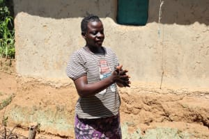 The Water Project: Emulakha Community, Nalianya Spring -  A Community Member Showing The Group How She Does Her Handwashing