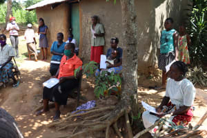The Water Project: Emulakha Community, Nalianya Spring -  Community Members Listening In