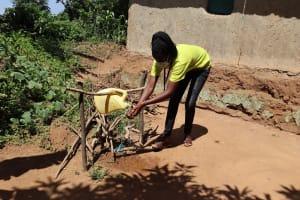 The Water Project: Emulakha Community, Nalianya Spring -  Ms Gladys Using The Handwashing Station