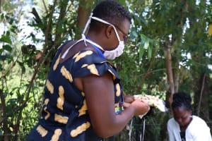 The Water Project: Sambuli Community, Nechesa Spring -  Facilitator Leading Participants On Making Of Masks