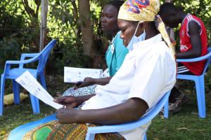 The Water Project: Sambuli Community, Nechesa Spring -  Participants Following Training Using Handouts