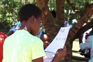 The Water Project: Sambuli Community, Nechesa Spring -  Using Handouts At The Training