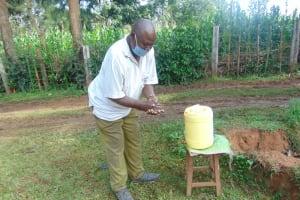 The Water Project: Shihungu Community, Shihungu Spring -  An Elderly Man Handwashing
