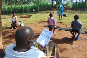 The Water Project: Shihungu Community, Shihungu Spring -  Following Training Using Manuals