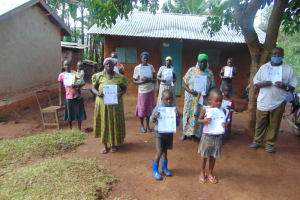 The Water Project: Shihungu Community, Shihungu Spring -  Participants Show Their Manuals After Training