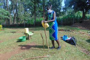 The Water Project: Shihungu Community, Shihungu Spring -  Setting Up A Handwashing Station