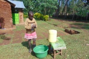 The Water Project: Shihungu Community, Shihungu Spring -  Sheila Practicing Handwashing