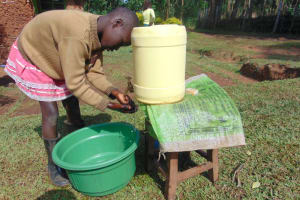 The Water Project: Shihungu Community, Shihungu Spring -  Using Handwashing Station