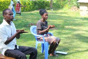 The Water Project: Emukangu Community, Okhaso Spring -  Participants Follow On Handwashing Demonstration