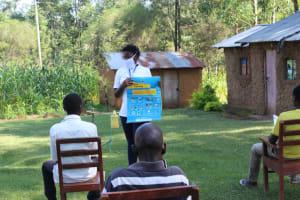 The Water Project: Emukangu Community, Okhaso Spring -  Use Of Charts At The Training