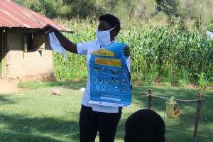 The Water Project: Emukangu Community, Okhaso Spring -  Use Of Charts Issued By Ministry Of Health On Coronavirus