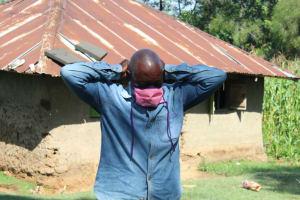 The Water Project: Emukangu Community, Okhaso Spring -  Village Elder Tries On His New Mask