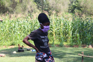 The Water Project: Emukangu Community, Okhaso Spring -  Wearing A New Mask Sewn At The Training