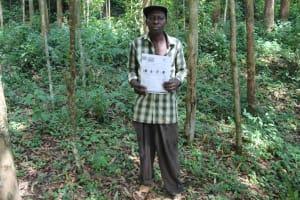 The Water Project: Eshiasuli Community, Eshiasuli Spring -  A Community Member Holding His Training Handout