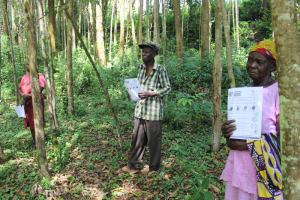 The Water Project: Eshiasuli Community, Eshiasuli Spring -  Community Members Show Their Handouts