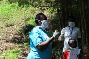 The Water Project: Eshiasuli Community, Eshiasuli Spring -  Use Of Water And Soap Vital In Breaking Down Virus