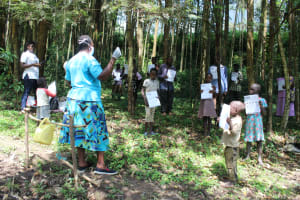 The Water Project: Eshiasuli Community, Eshiasuli Spring -  Using Handouts To Follow The Training