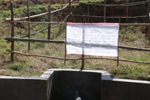 The Water Project: Kalenda A Community, Webo Simali Spring -  Installed Reminder Chart At The Spring