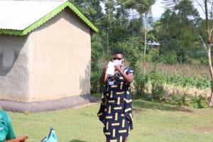 The Water Project: Kalenda A Community, Webo Simali Spring -  Mask Making Demonstrations