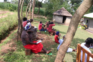 The Water Project: Kalenda A Community, Webo Simali Spring -  Practical Session Of Coughing Into Elbow