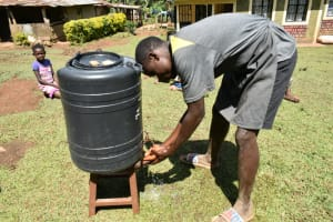 The Water Project: Shamiloli Community, Kwasasala Spring -  A Handwaashing Tank In A Community Household
