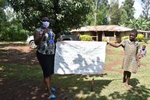 The Water Project: Shamiloli Community, Kwasasala Spring -  Using Charts At The Training
