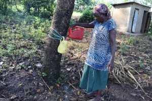 The Water Project: Sasala Community, Kasit Spring -  Filling The Handwashing Station With Clean Water