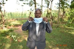 The Water Project: Eshiakhulo Community, Kweyu Spring -  David Kweyu Shows How He Puts On His Mask
