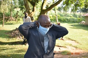 The Water Project: Eshiakhulo Community, Kweyu Spring -  David Kweyu Puts On His Mask