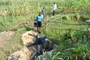 The Water Project: Eshiakhulo Community, Kweyu Spring -  David Kweyu With Other Water Users