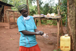 The Water Project: Ataku Community, Ngache Spring -  Catherine Washes Her Hands