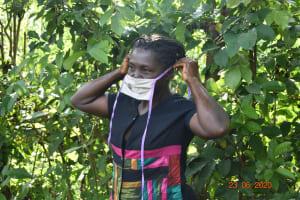 The Water Project: Shikhombero Community, Atondola Spring -  Serilah Puts On Her Mask